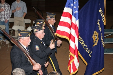 American Legion Post #239 retires the colors at the end of the Hay Springs Veteran's Day program on Monday.